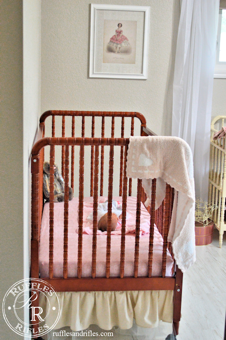 baby girl in sweet nursery